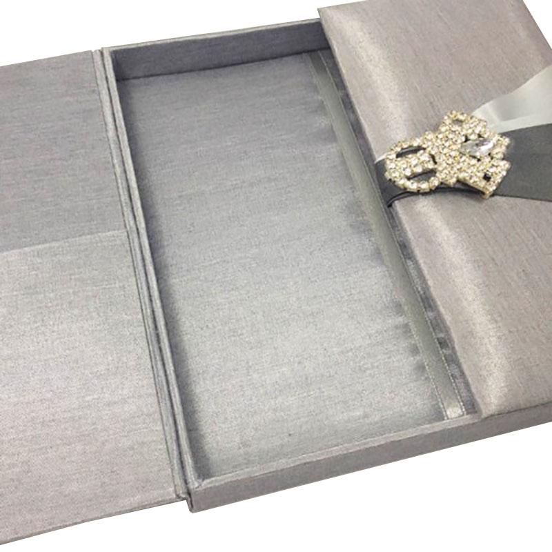 silver gatefold wedding invitation box with brooch