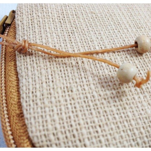 Detail view of waxed cord on zippered hemp pouch with wooden beads