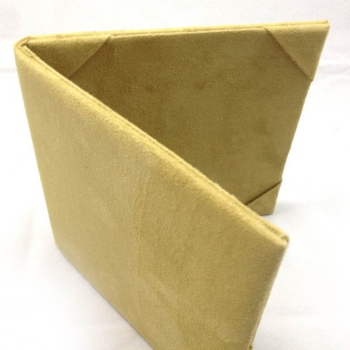 Top view of suede covered folio for wedding and event invitation cards