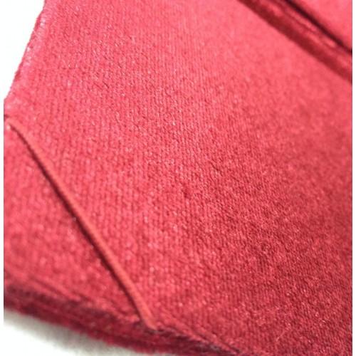 Red elastic band on a corner of a red velvet folder