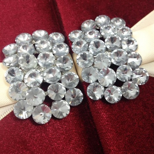 Rhinestone brooch set on velvet folder