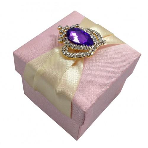 Purple rhinestone crown brooch on pink silk favor box