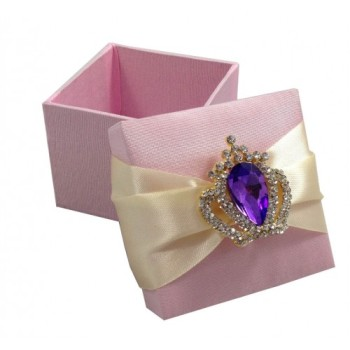 Purple rhinestone crown brooch on pink silk favor box