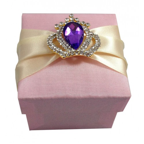Pink wedding favor box with purple crown brooch