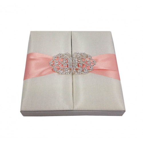 Ivory silk gatefold box with blush pink ribbon and clasp
