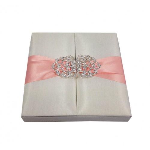 Ivory silk gatefold box with blush pink ribbon and clasp