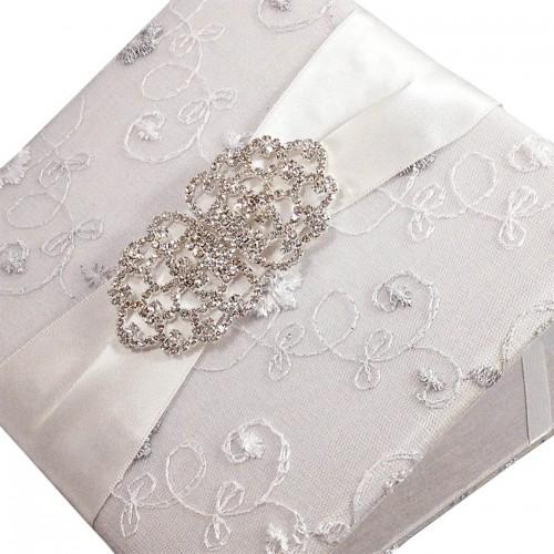 Large rhinestone brooch on lace invitation folio