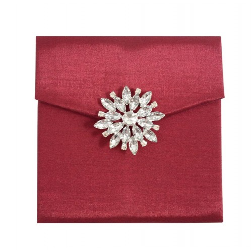 Red silk envelope with pocket holder and snow flake brooch