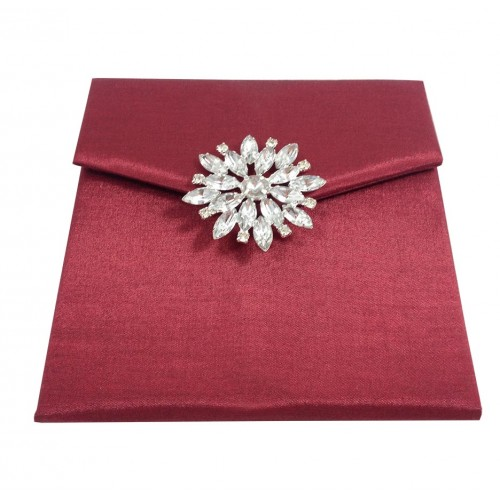 Front view of star brooch embellished silk envelope