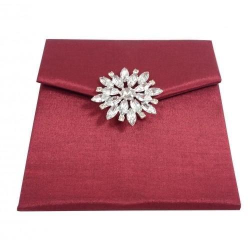 Front view of star brooch embellished silk envelope