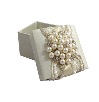 Pearl brooch and lace embellished ivory favor box for wedding