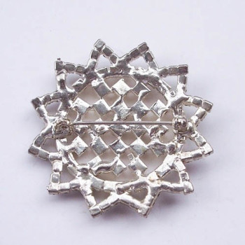 Back of star brooch with stitch pin