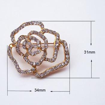 Golden rose brooch