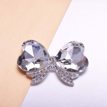 crystal bow brooch