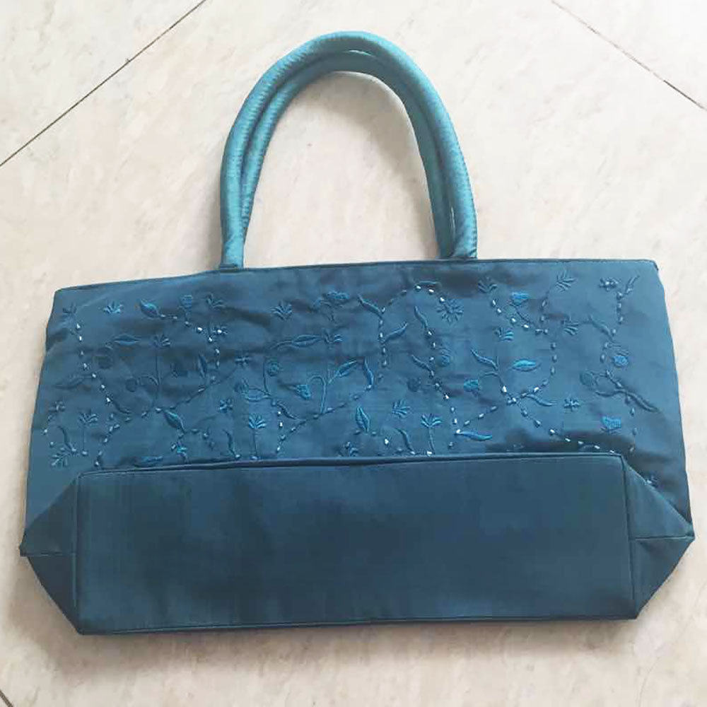 dark turquoise bag with embroidery