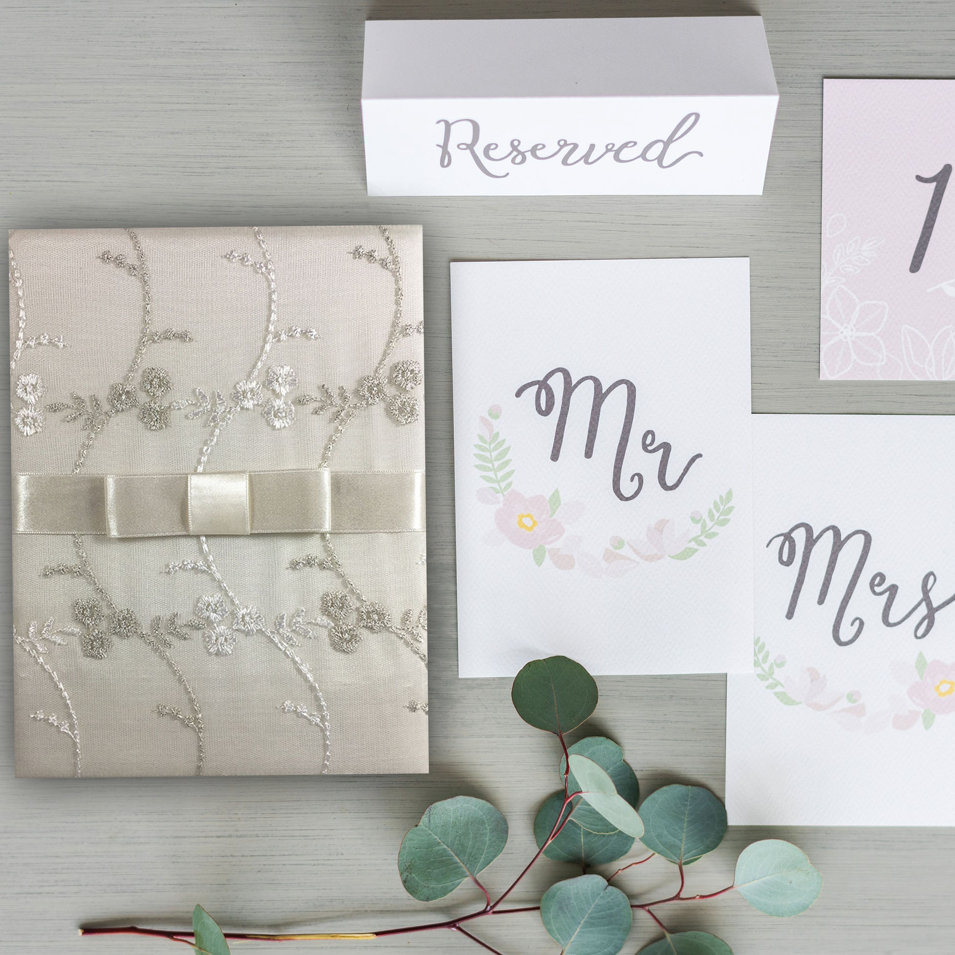 Embroidered lace invitation with bow
