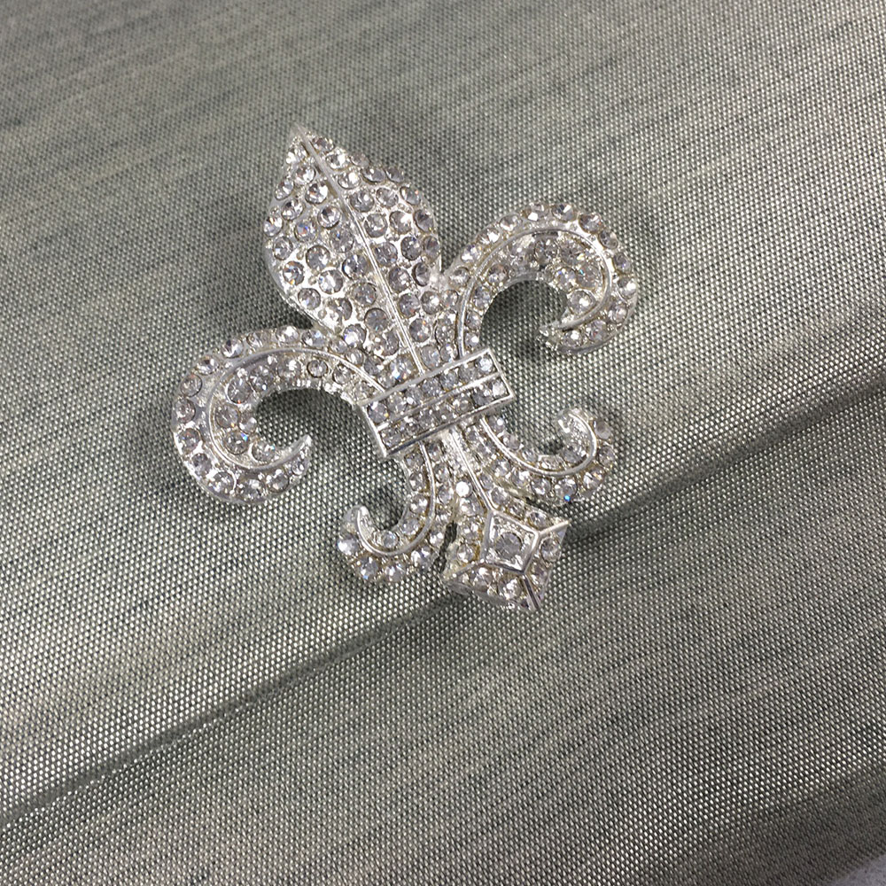 fleur de lis brooch on silk envelope