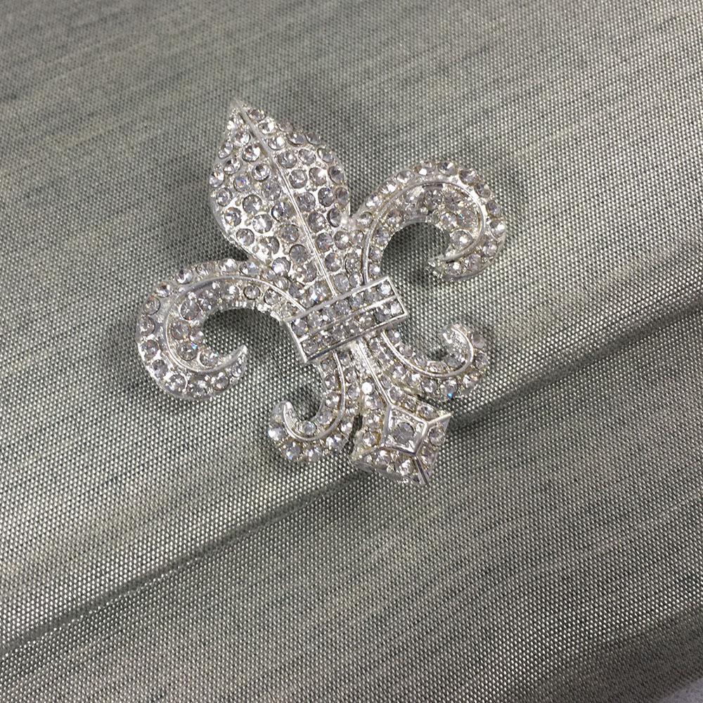 fleur de lis brooch on silk envelope