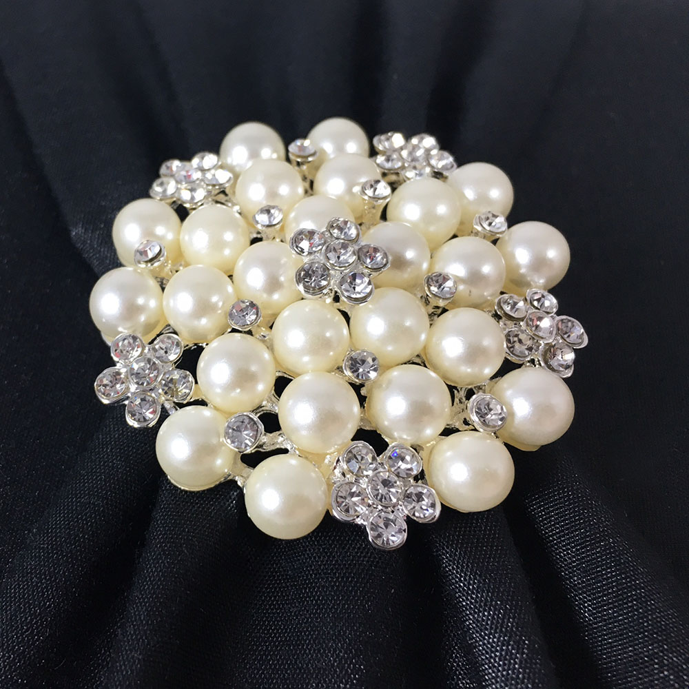 pearl brooch on box