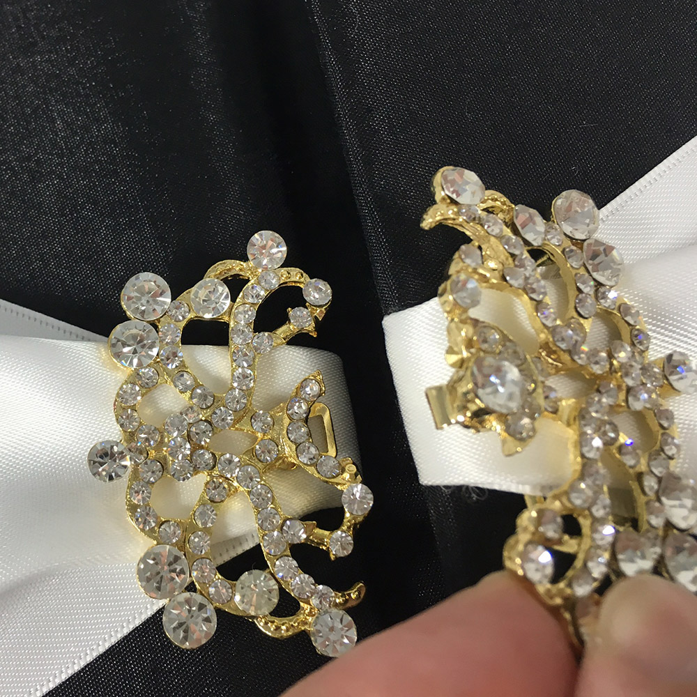 Golden brooch wedding embellishment