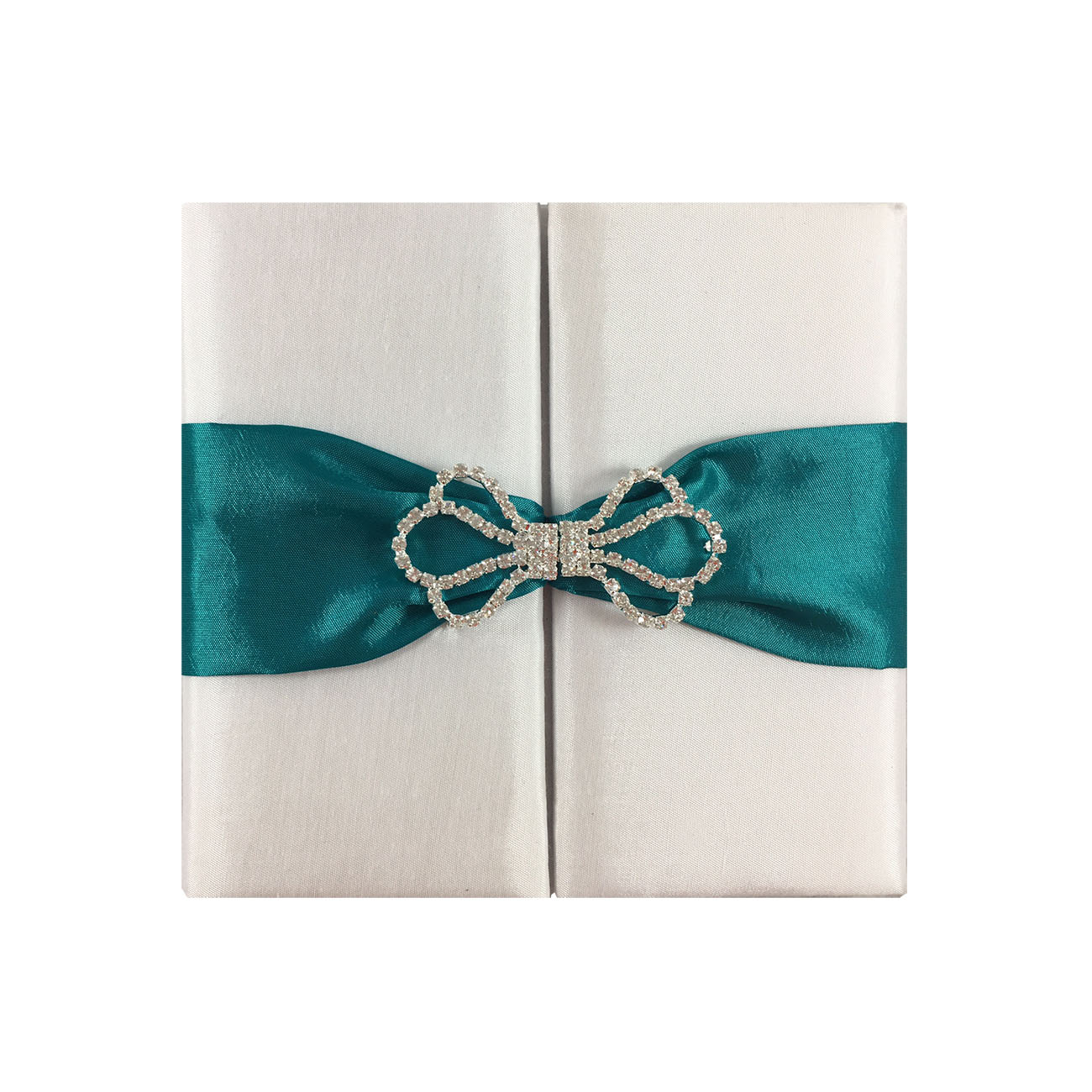 White wedding invitation with teal ribbon and rhinestone clasp