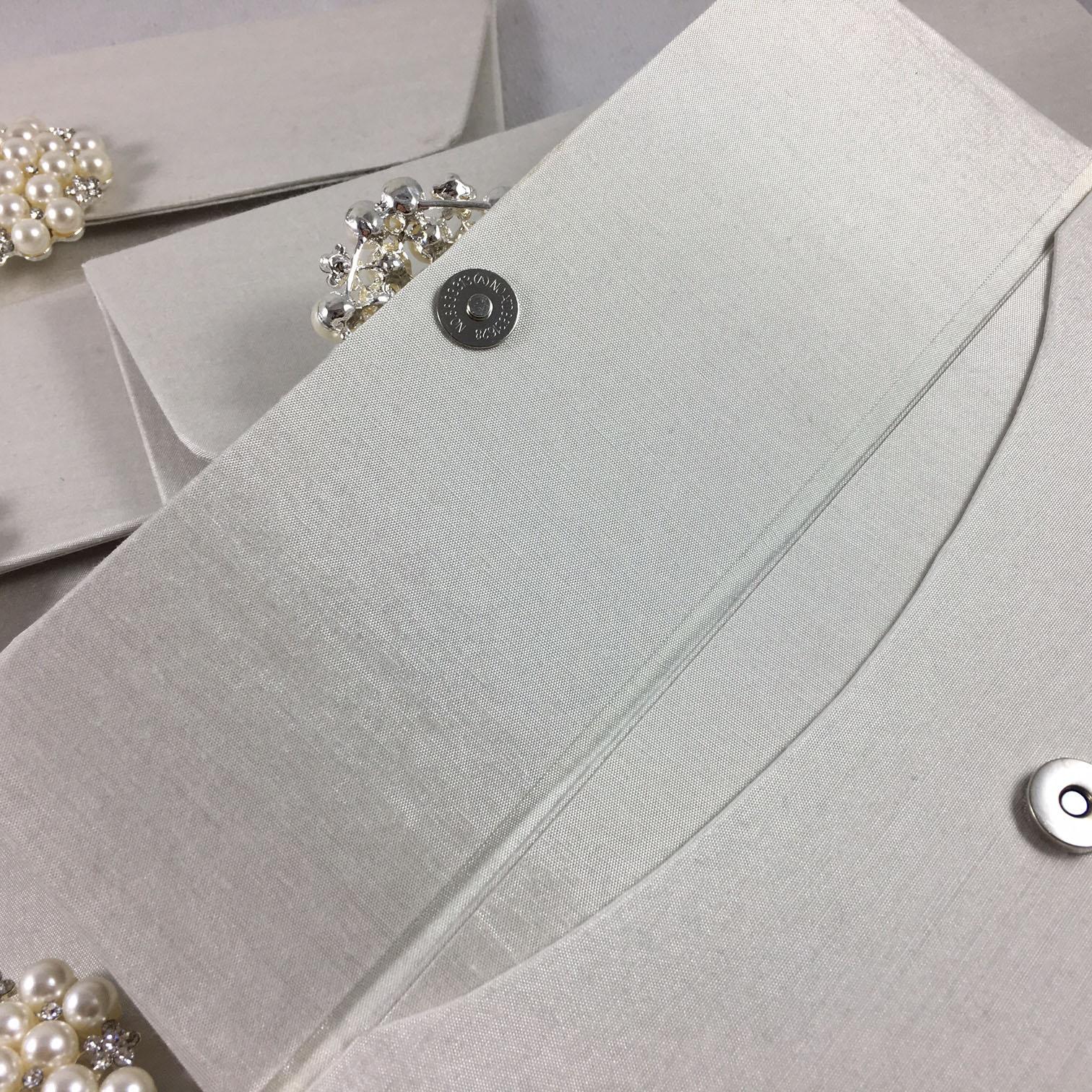 ivory wedding envelope with pearl brooch