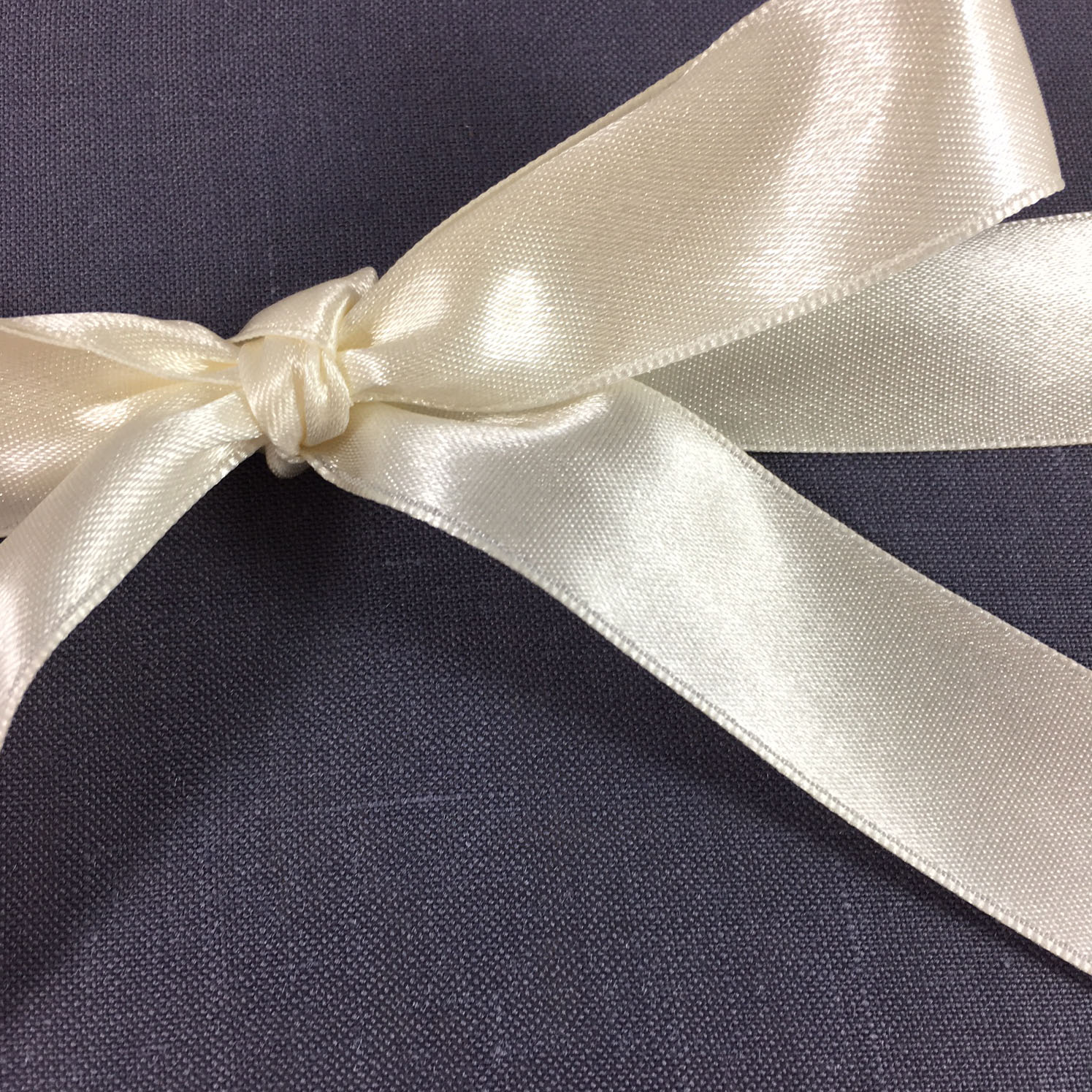 ivory satin bow on linen