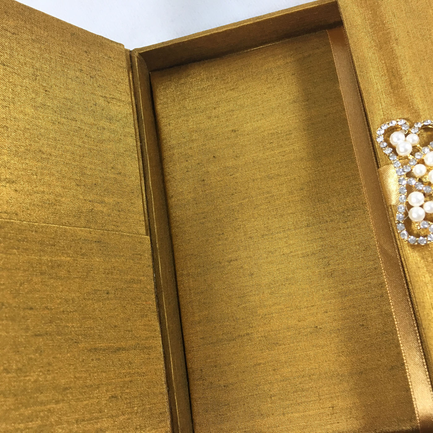 Goldenrod silk box with pearl brooch