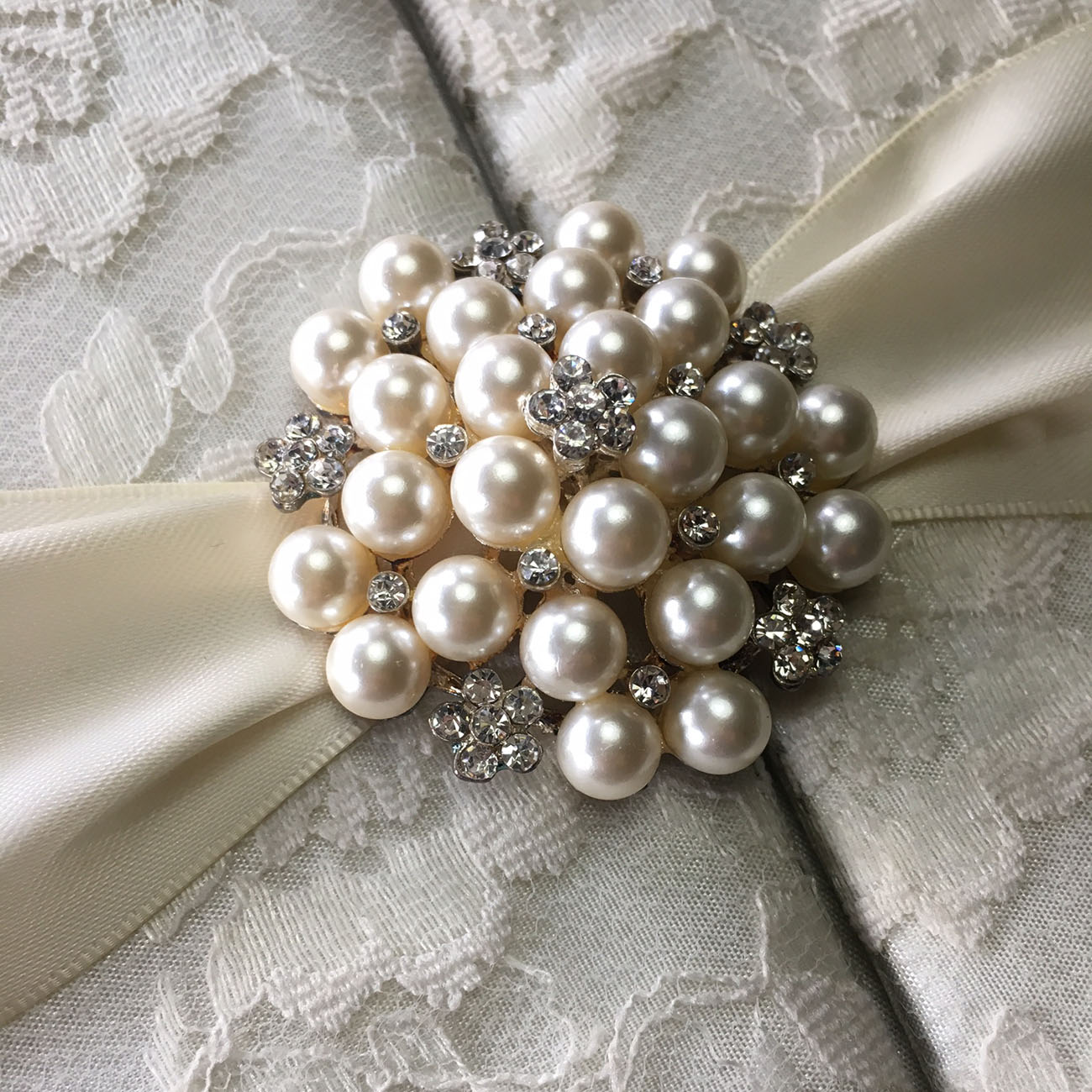 pearl brooch embellished lace invitation