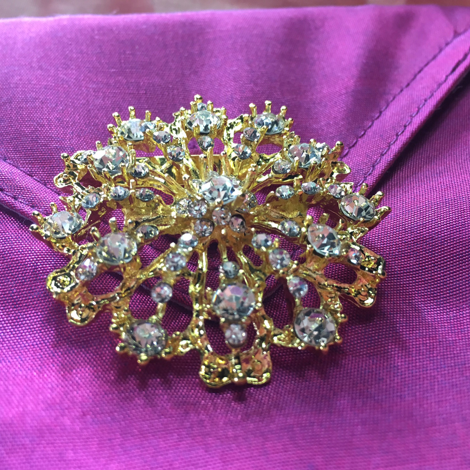 Golden wedding brooch