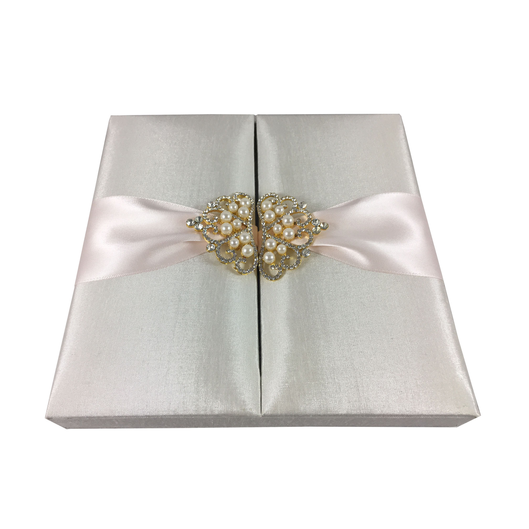 Ivory wedding box with blush ink ribbon and golden crown pearl brooch