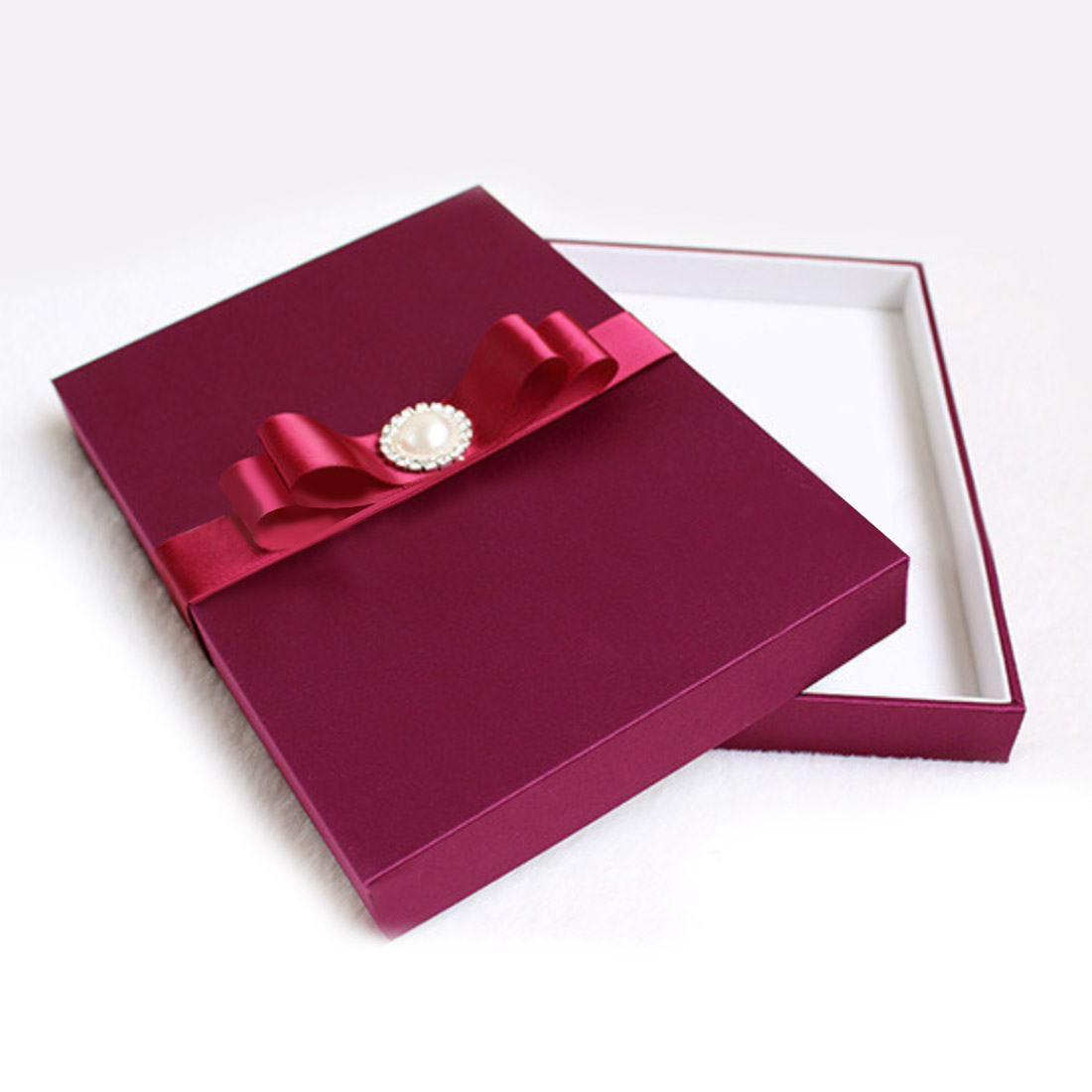 ruby silk wedding box with pearl brooch