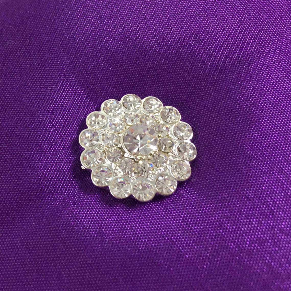 crystal button brooch