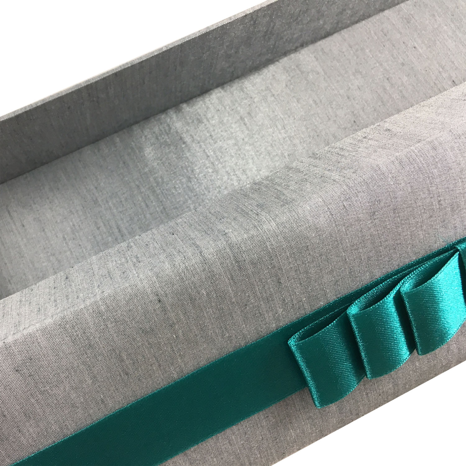 silver silk box with teal ribbon