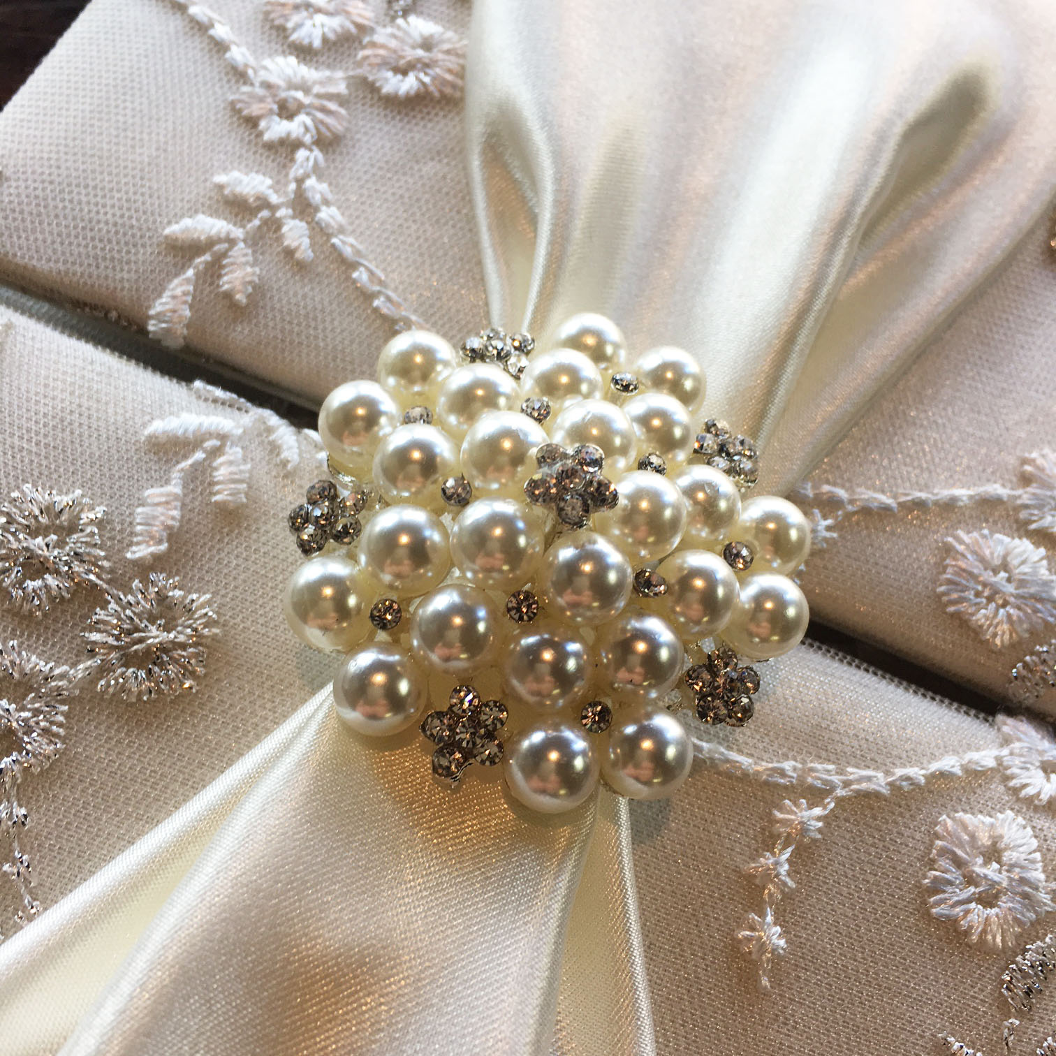pearl brooch on lace fabric