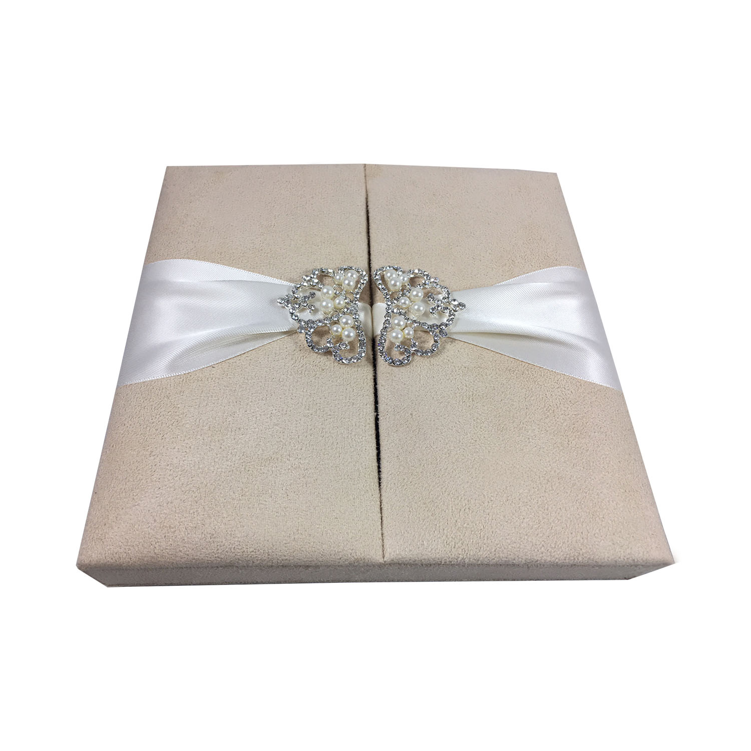 cream suede box with pearl crown brooch embellishment