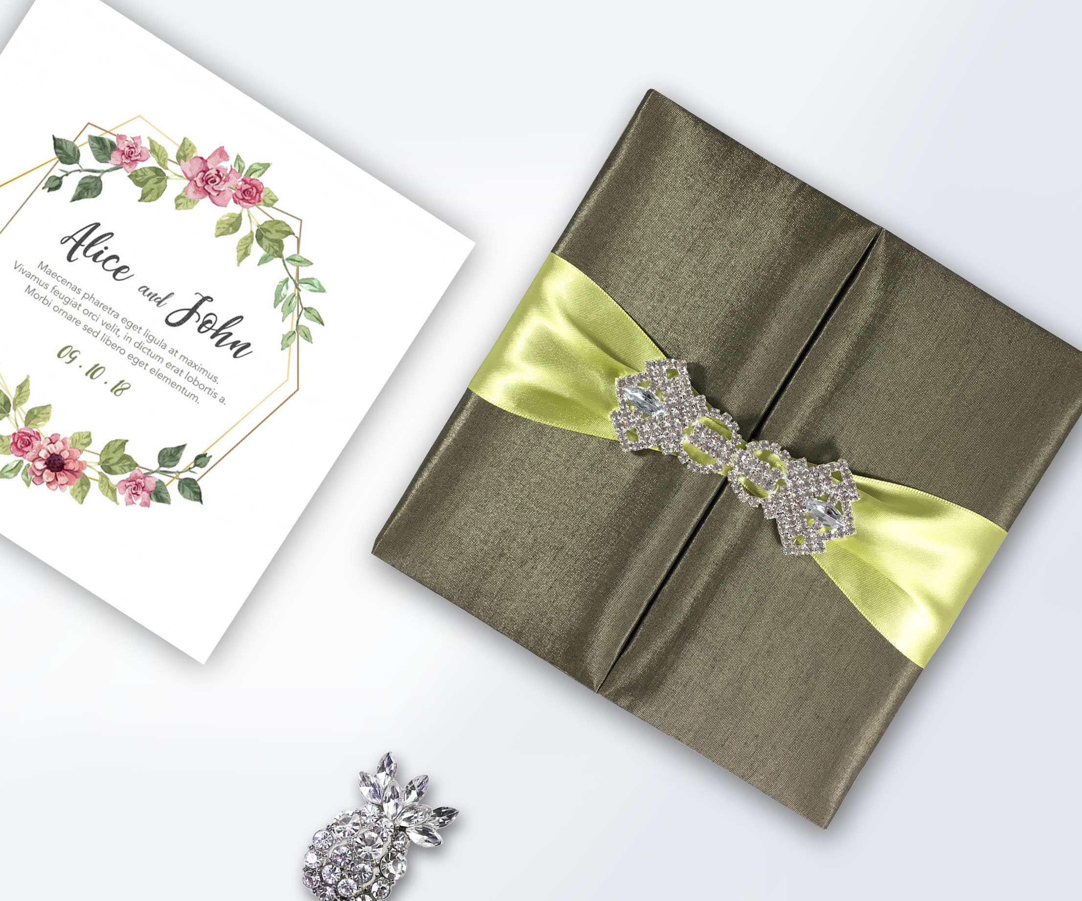 uniform green silk wedding box with chartreuse ribbon and crystal brooch