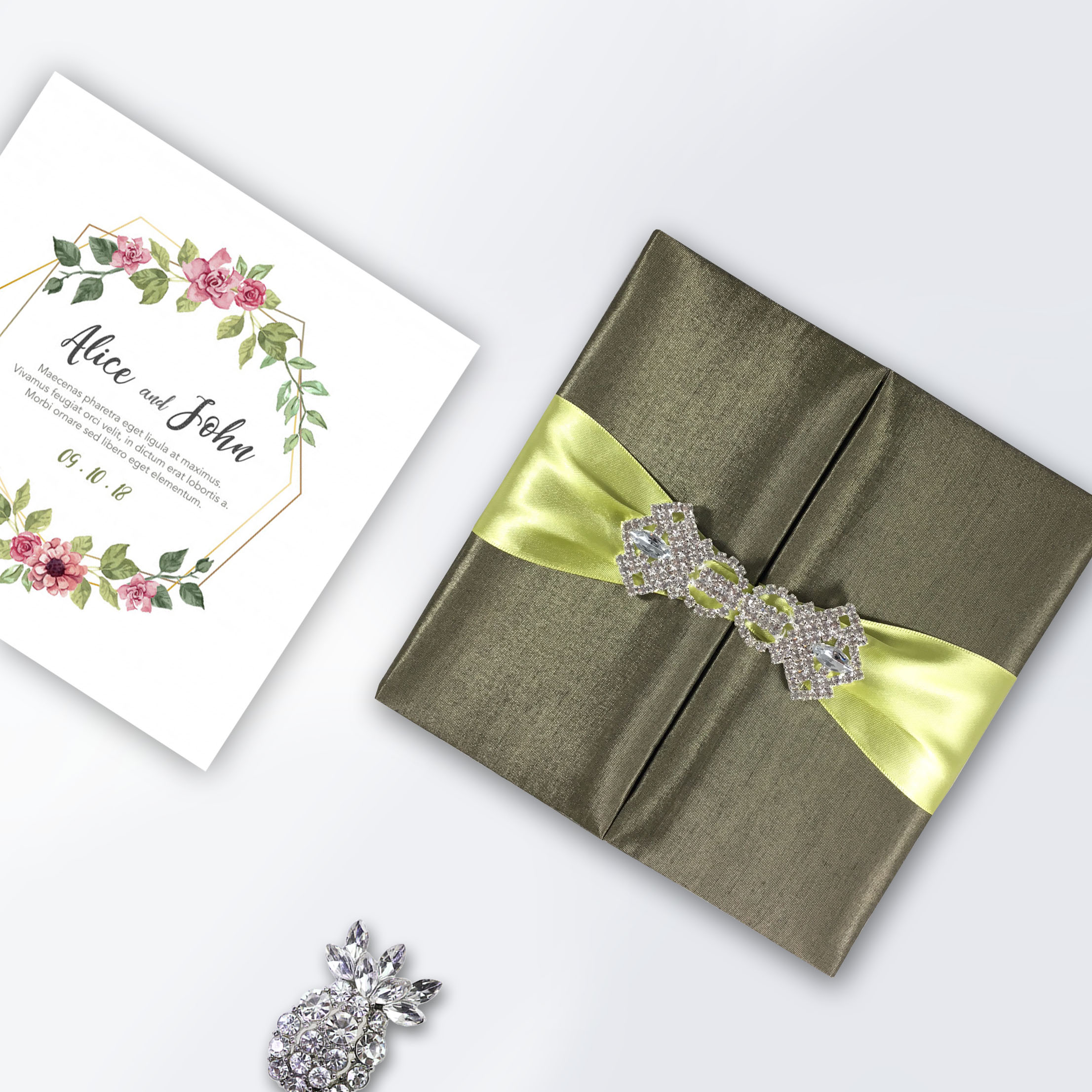 boxed wedding invitation with wedding brooch