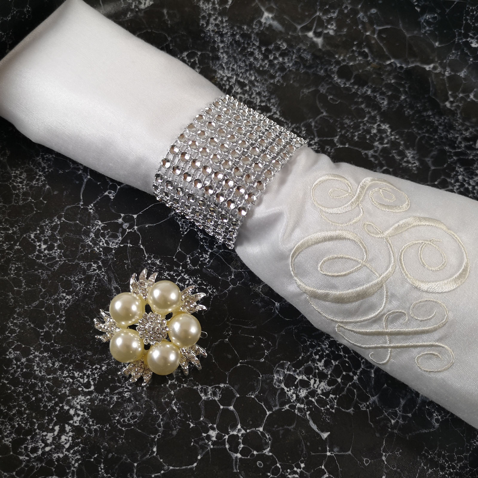 Wedding reception table napkin with crystal