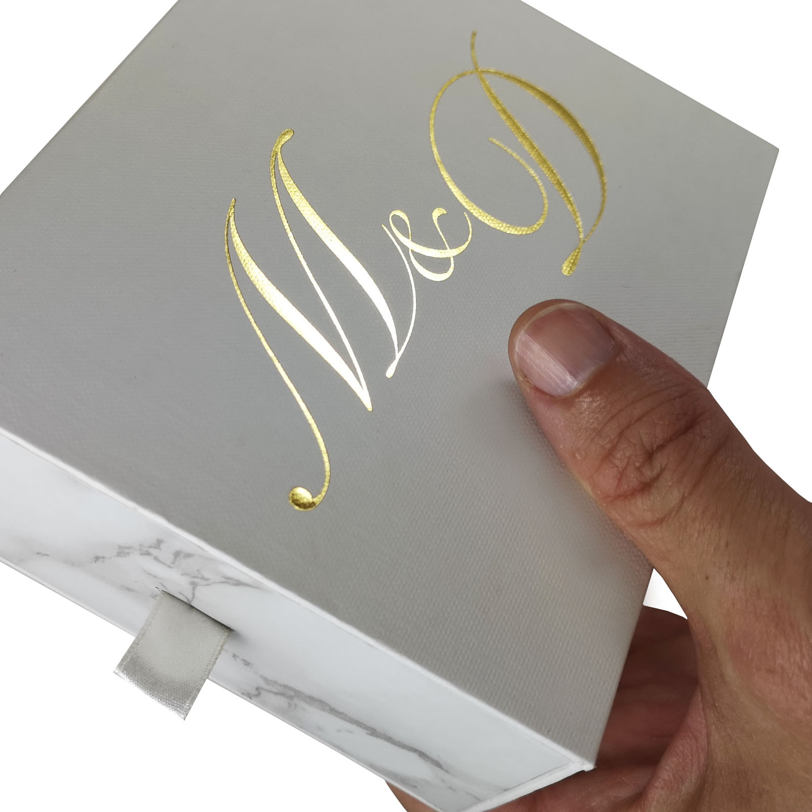 Marble drawer box with ribbon pull and gold foil stamped logo