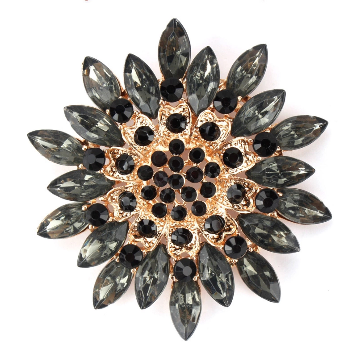 Golden flower brooch with black rhinestones