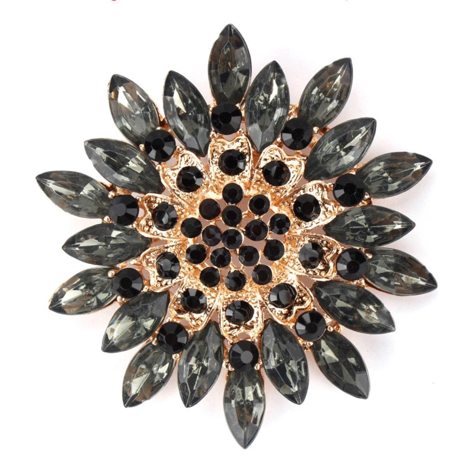 Golden flower brooch with black rhinestones