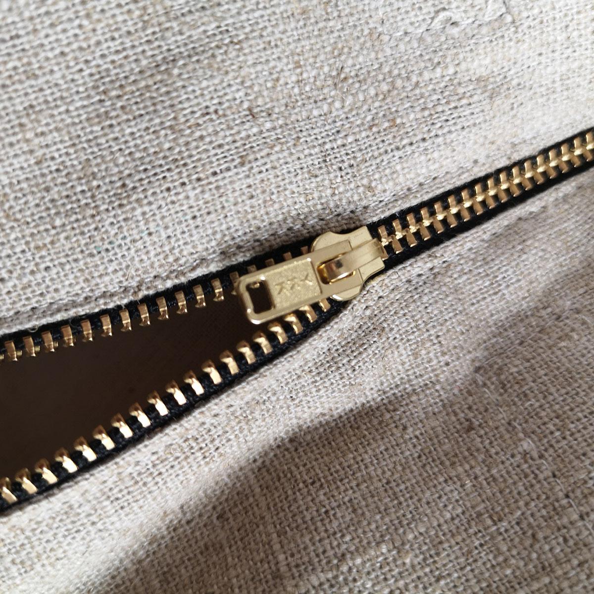 golden zipper pull